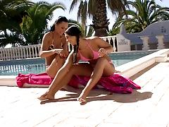 Lesbian couple massage and fuck each other at the poolside